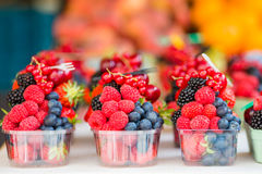 Berry fruits at a marketplace. Blueberries, raspberries, strawberries, cherries and blackberries on the market. Berries fruits at a marketplace. Blueberries Stock Photo