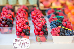 Berry fruits at a marketplace. Blueberries, raspberries, strawberries, cherries and blackberries on the market. Berries fruits at a marketplace. Blueberries Royalty Free Stock Photos