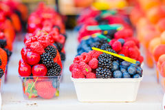 Berry fruits at a marketplace. Blueberries, raspberries, strawberries, cherries and blackberries on the market. Berries fruits at a marketplace. Blueberries Stock Images