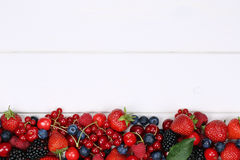 Berry fruits on wooden board with strawberries, blueberries, che Royalty Free Stock Photography