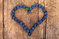 Berry heart. Shape of heart made of blueberries on wooden table Stock Photo