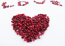 Berry heart on the snow Stock Photo