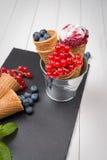 Berry ice cream cone Stock Images