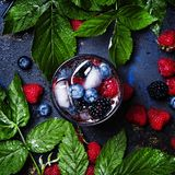 Berry iced cocktail with vodka, juice, soda, blueberry, blackberry and raspberry, top view stock photos