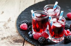 Berry icy cocktail with blueberries, blackberries and raspberries, selective focus stock images