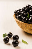 Berry Jaboticaba in bowl on wooden table Royalty Free Stock Photography