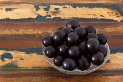 Berry Jaboticaba in glas bowl on wooden table Royalty Free Stock Photography