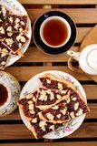 Berry jam cookies in white plate, two cup of tea, white teapot o Stock Image
