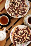 Berry jam cookies in white plate, two cup of tea, white teapot o Royalty Free Stock Photo
