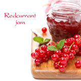 Berry jam and fresh red currants, isolated Royalty Free Stock Images