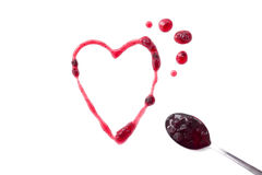 Berry jam heart and spoon full of jam Royalty Free Stock Photos