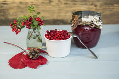 Berry jam and red berries on a wooden background. Close up royalty free stock photography