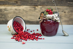 Berry jam and red berries on a wooden background. Close up stock photography