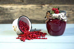 Berry jam and red berries on a wooden background. Close up stock photos