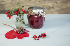 Berry jam and red berries on a wooden background. Close up royalty free stock photos
