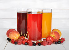 Berry juice in glasses. With fresh berries on wooden background Royalty Free Stock Photography