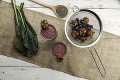 Berry, Kale and chia smoothie. Healthy Berry and Kale smoothie with ingredients Stock Image