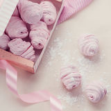 Berry marshmallow in a gift box on a pink background Stock Image
