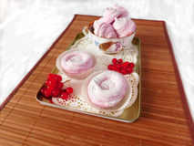 Berry marshmallow for tea. Berry marshmallow covered with sugar powder for tea-party royalty free stock photography