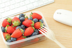 Berry mix lunch box at office Royalty Free Stock Photography