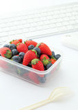 Berry mix lunch on working desk in office Royalty Free Stock Photography