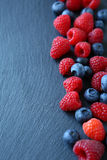 Berry mix on the slate background Royalty Free Stock Photos