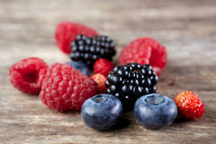 Berry mix on wood. En background royalty free stock photo