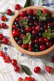 Berry mix in a wooden bowl close-up. Vertical Royalty Free Stock Images