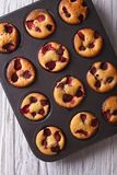 Berry muffins close up in baking dish. vertical top view Stock Photography