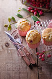 Berry muffins on a rustic dark wooden background Royalty Free Stock Images