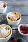 Berry muffins on wooden background Royalty Free Stock Image