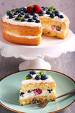 Berry and nut cream cake. On plate royalty free stock photography