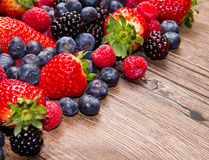 Berries on Wooden Background Royalty Free Stock Image