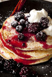 Berry Pancakes. Pancakes topped with a compote of blackberries and blueberries, and yogurt stock images