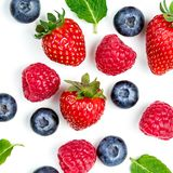 Berry Pattern. Fresh berries isolated on white background, top v. Iew. Strawberry, Raspberry, Blueberry and Mint leaf, flat lay Royalty Free Stock Image