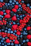 Berry Pattern. Fresh Summer Berries mix Background with Strawberry, Raspberry, Red currant, Blueberry and Blackberry, top view.  stock images