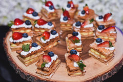 Berry Pie cakes in wooden tray for buffet event. Stock Image