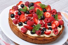 Berry pie with fresh strawberries, raspberries, currants, mint Royalty Free Stock Photography