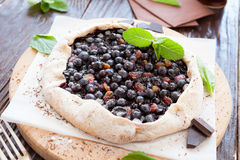 Berry pie with a slice of black chocolate Stock Photo