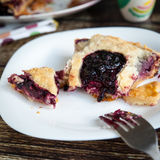 Berry pie with strawberries and blueberries. (segment) on wooden table Stock Photo