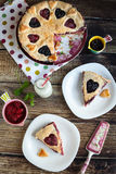 Berry pie with strawberries and blueberries. (segments) on wooden table and on fabric with color dots Stock Images