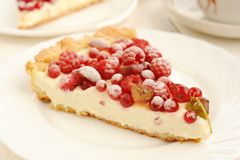 Berry pie with whipped cream filling close up. On white plate Stock Photography