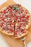 Berry pie with whipped cream filling and sugar powder. On wood board Royalty Free Stock Photo