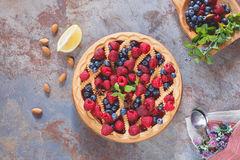 Berry pie. Whole homemade mixed berry lattice top pie on rustic table, top view Royalty Free Stock Image