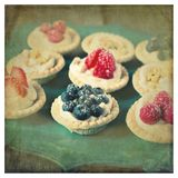 Berry pies on a tray with texture Stock Image