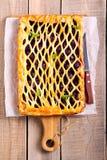 Berry puff pastry lattice. Pie on board stock image