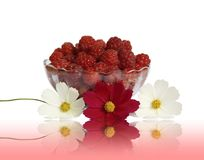 Berry raspberries in a glass vase on a table Stock Image