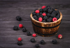 Berry raspberry and blackberry in basket. At wooden board rustic style Stock Image