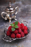 Berry red raspberry and mint leaf Stock Photos