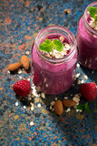 Berry smoothie in a bottle and dark background, closeup top view Stock Photos